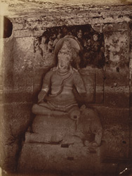 [Sculptured figure of Indra seated on an elephant in a small cave in the courtyard of Jain Cave XXXII (Indra Sabha), Ellora.]